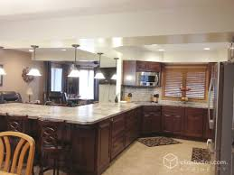 peninsula kitchen cabinets this traditional g shaped kitchen features the carlton raised