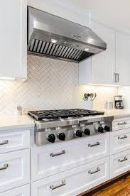 Kitchen Tile Backsplashes by White Quartz Countertops And The Backsplash Is Carrera Marble