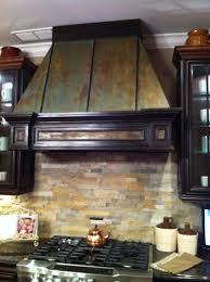how to match kitchen cabinets faux rust on kitchen hood and faux trim to match kitchen cabinets