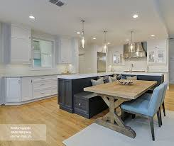 walnut kitchen island kitchen featuring an island with bench seating omega