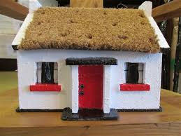 made replica thatched cottage crafted by an artisan in