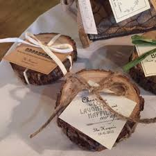 rustic wedding favors wedding favors cut logs with candle inside with raffia