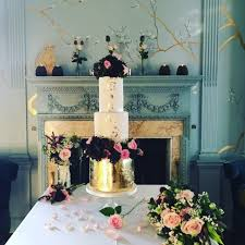 goldleaf weddingcake luxury roses flowers pink purple gold