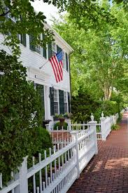 Massachusetts Travel Home images Shuttered white clapboard house and fence with a hanging flag
