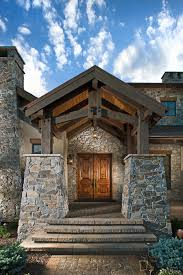 colorado luxury home exterior stone entryway home built by
