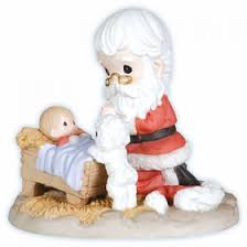 santa kneeling at the manger moments santa kneeling at manger figurine