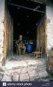 an old wine maker exudes contentment in a cellar in cyprus stock