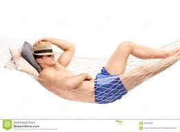 guy in blue swim trunks sleeping in a hammock stock photo image