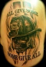 grey ink firefighter skull and flames tattoos on shoulder