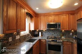 oak cabinets with granite oak cabinets and mosaic backsplash traditional kitchen