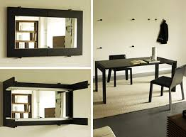 foldaway dining table folding dining table turns into a mirror by porada dining walls