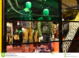 man fashion clothing shop window with mannequins christmas