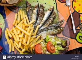 la cuisine collioure sardines and chips on a colourful table in a cafe at