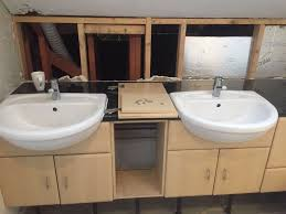 matching pair of large white bathroom sinks for sale in
