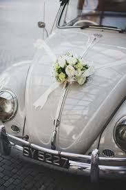 simple car decor with a ribbon and bouquet indian