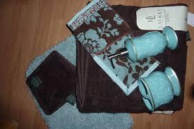 brown and blue bath towels towel