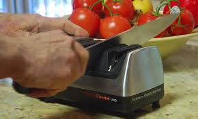 11 facts and falsehoods about kitchen knife sharpening ron asian styl images knife being sharpened using a chef s choice electric knife sharpener