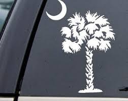 palmetto tree and crescent symbols of home