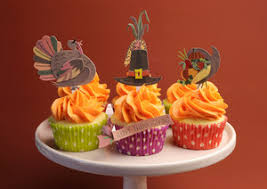 happy thanksgiving decorated cupcakes with turkey pilgrim hat and