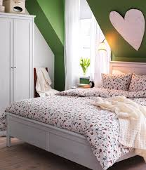 small kids bedroom with attic ceiling with green stained wall and