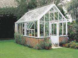 Affordable Houses To Build Building A Greenhouse Can Be Inexpensive If You Use Recycled Doors