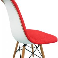 red fabric upholstered eames style accent chair with walnut