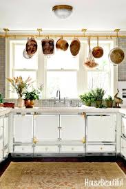 white metal cabinets with wood countertop learning to love my 50s