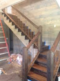 rustic wooden stairs shiplap walls r a i l i n g s