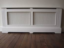 wooden bed next to radiator kashiori com wooden sofa chair