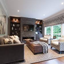 pictures of living rooms with fireplaces the dark accent wall fireplace and custom wood floors add warmth