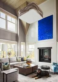 an elegant calgary home inspired by big sky country western living the double height ceiling in the living room gets extra drama with a detailed angled treatment