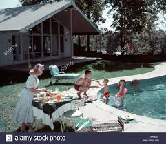 1950 S House by 1950s Family Of 4 Backyard Swimming Pool House Mom Serving Food