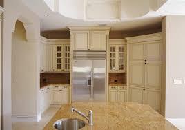 caramel granite kitchen mediterranean with ivory french toile