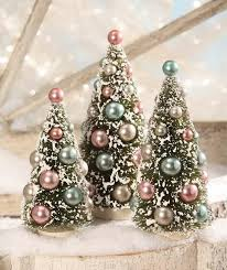 pastel bottle brush trees snow frosted with pink blue silver