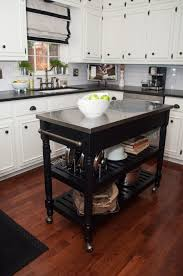 kitchen with two islands black stained wooden movable kitchen island with two tier shelves