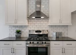 black kitchen cabinets with white subway tile backsplash subway tile 16 new reasons to the look bob vila