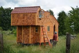 off grid tiny house looks like it belongs in a fairytale