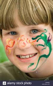 9 year old boy with face painting at his birthday party