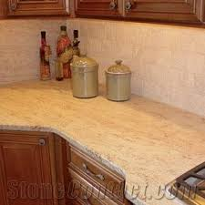 what color granite goes with golden oak cabinets golden oak granite countertops yellow granite