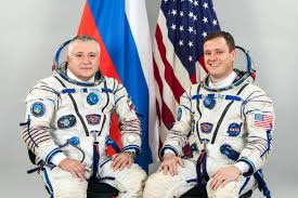 russian american crew duo on the eve of liftoff on 136 day space