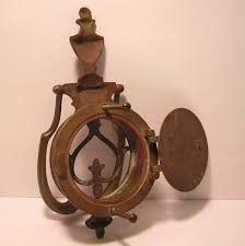 antique victorian brass speakeasy door knocker and peep hole