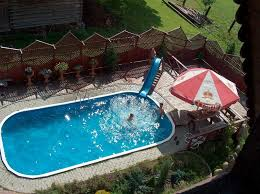 Backyard Pool Ideas Pictures Swimming Pool Striking Oval Shape Backyard Pool Design Ideas