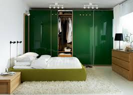simple modern bedroom designs for couples with green bed and white