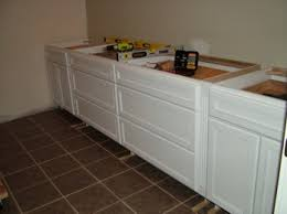 how to put filler on kitchen cabinets cabinet installation