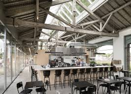 old train shed is transformed into a gorgeous office and