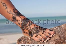 henna tattoo on the feet of a woman from zanzibar tanzania