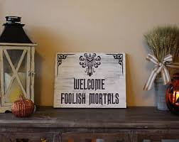 haunted mansion home decor welcome foolish mortals disney disney haunted mansion wood