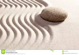 symbol of feng shui in sand and stone royalty free stock images