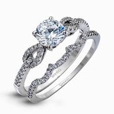 accented by charming teardrop side designs this lovely white gold