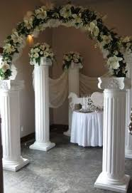 wedding backdrop ideas with columns how the black fabric stands out against the white wedding